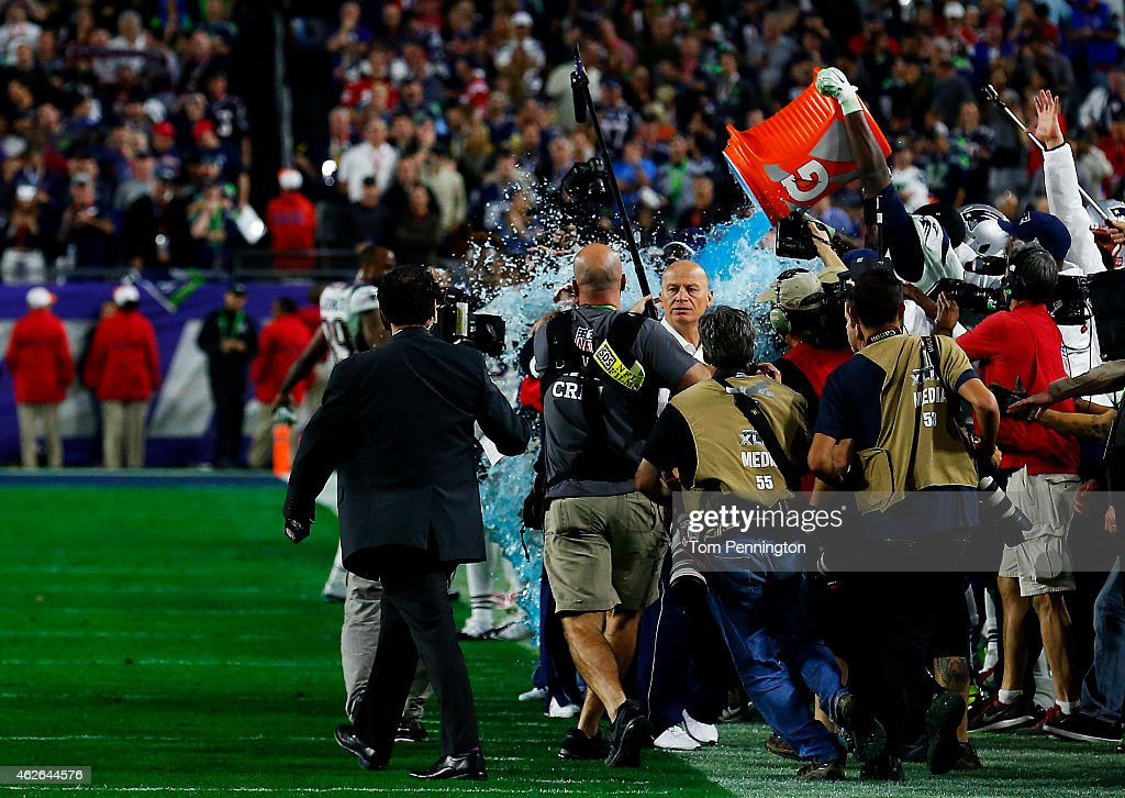 The New England Patriots celebrate late in the game with head coach Bill Belichick during Super Bowl XLIX at University of Phoenix Stadium on February 1, 2015 in Glendale, Arizona.