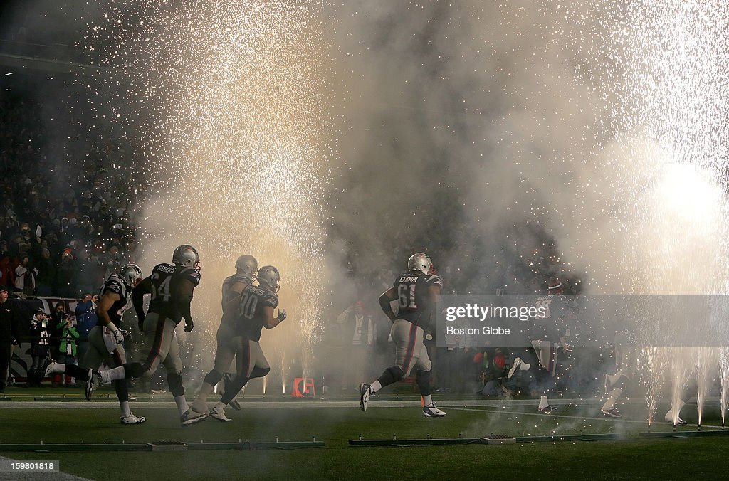 The New England Patriots enter the stadium to fireworks before playing the Baltimore Ravens in the AFC Championship Game at Gillette Stadium.