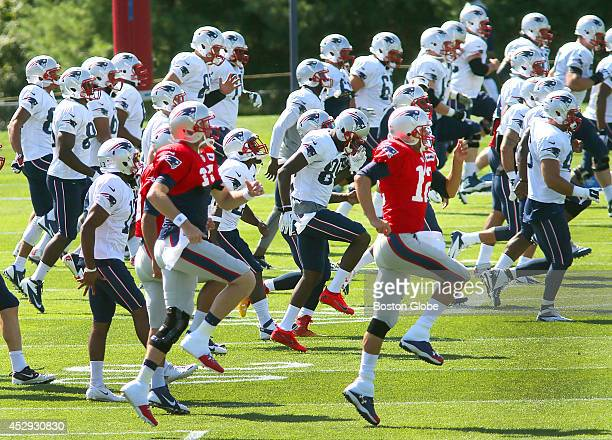 The New England Patriots held another training camp session at their practice field next to Gillette Stadium They started off the morning with warmup...
