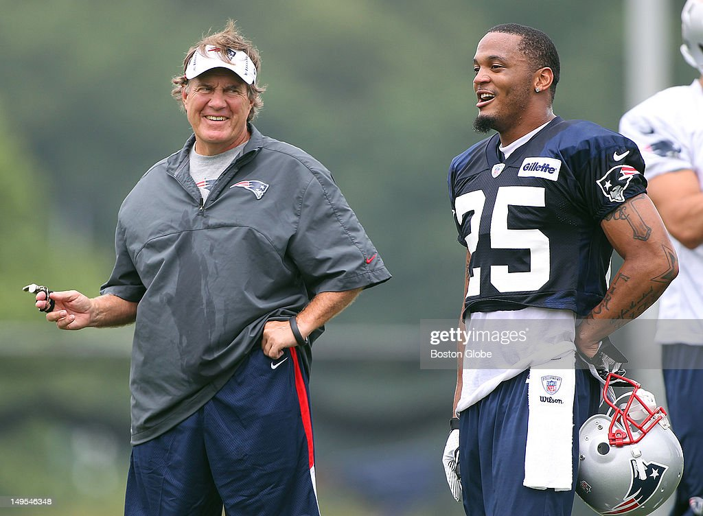The New England Patriots held practice at the practice fields at Gillette Stadium. Bill Belichick cracks a smile in a discussion with Patrick Chung.