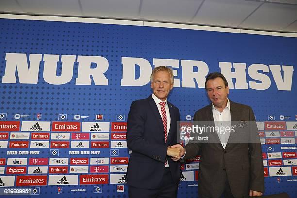 The new Executive Director of Sport Heribert Bruchhagen and Jens Meier of Hamburger Sport Vereinshake hands after the press conference at...