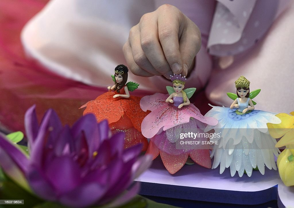 The new flower fairy dolls are present at a booth during the press preview of the international toy fair in Nuremberg, southern Germany, on January 29, 2013. Around 2.700 exhibitors show more than 1 million products at the international toy fair which opens its doors from January 29 to February 4, 2013.