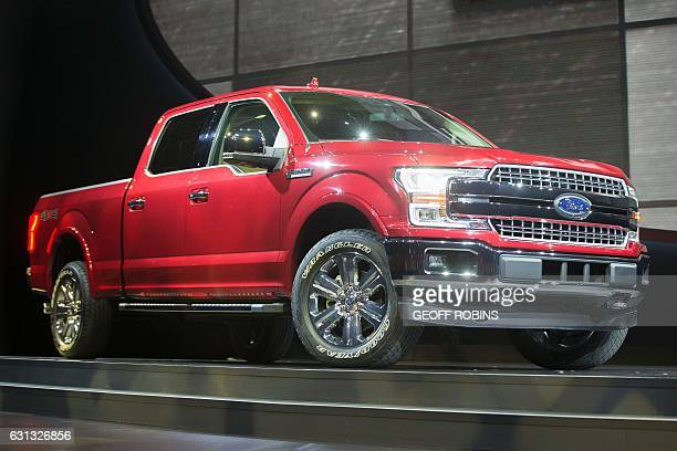 The new Ford F150 is introduced during the company's press conference at the 2017 North American International Auto Show in Detroit Michigan January...