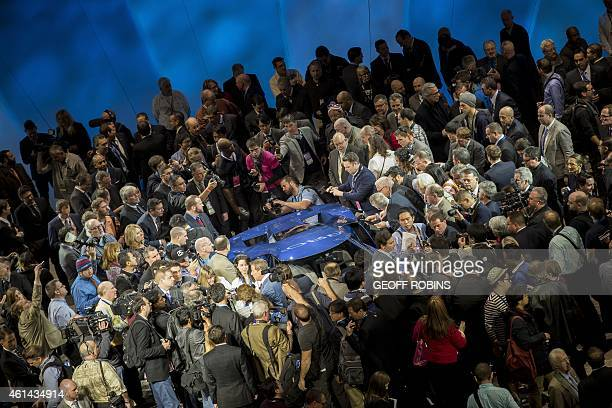 The new Ford GT is surrounded by journalists after its unveiling at the 2015 North American International Auto Show in Detroit Michigan January 12...