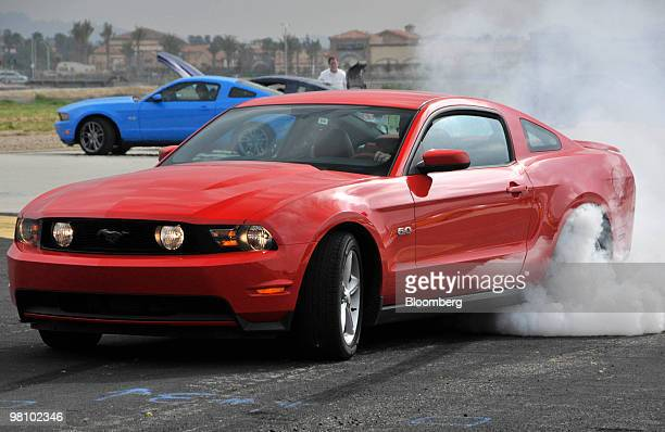 The new Ford Motor Co 2011 Mustang GT burns rubber at Camarillo Airport in Camarillo California US on Thursday March 25 2010 The new Mustang GT...