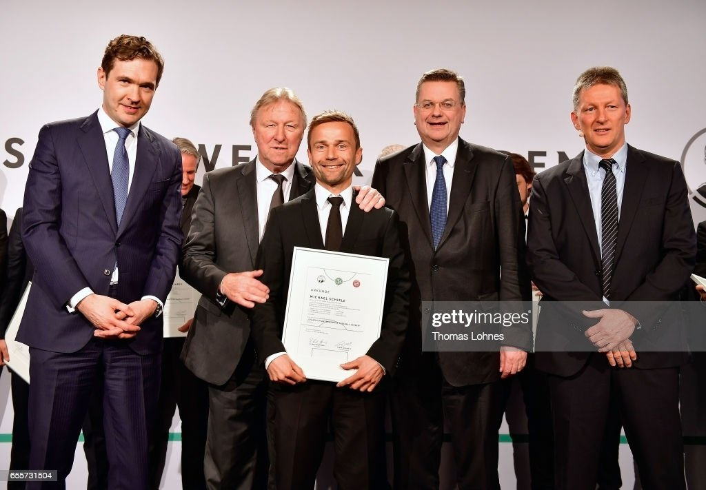The new fototball coach Michael Schiele stands with his certificate between DFB general secretary Friedrich Curtius, Horst Hrubesch, DFB president Reinhard Grindel and Frank Wortmuth (L-R) during the 'Coaching Award Ceremony & Closing Event UEFA Pro Coaching Course 2016/2017' on March 20, 2017 in Neu Isenburg, Germany.