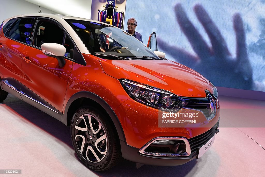 The new French Renault Captur model car is displayed as a world premiere at the Geneva International Motor Show on March 6, 2013. Global sales of cars, buses, utility vehicles and trucks are expected to grow three percent this year, down from five percent in 2012, according to a forecast published on March 6, 2013. The growth forecast, presented by the International Organisation of Motor Vehicle Manufacturers (OICA) at the Geneva Motor Show, is based on figures provided by the national car federations in three quarters of OICA member countries. AFP PHOTO / FABRICE COFFRINI