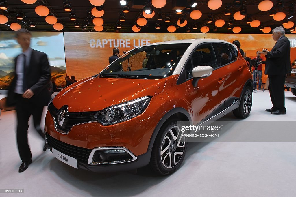 The new French Renault Captur model car is displayed as world premiere at the Geneva International Motor Show on March 6, 2013. Global sales of cars, buses, utility vehicles and trucks are expected to grow three percent this year, down from five percent in 2012, according to a forecast published on March 6, 2013. The growth forecast, presented by the International Organisation of Motor Vehicle Manufacturers (OICA) at the Geneva Motor Show, is based on figures provided by the national car federations in three quarters of OICA member countries. AFP PHOTO / FABRICE COFFRINI