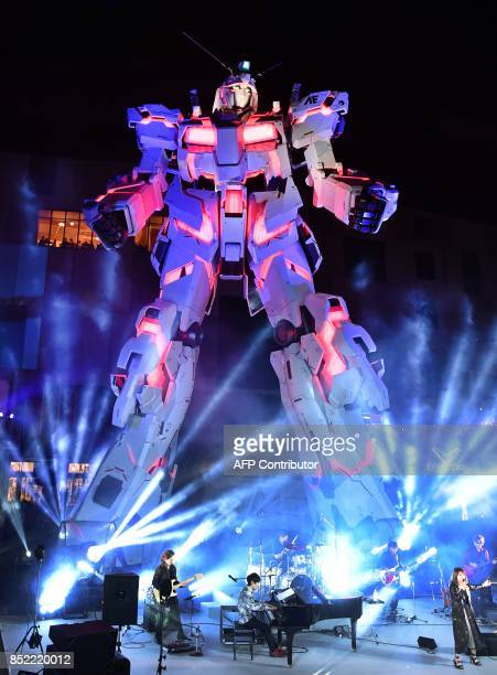 The new fullsize standing statue RX0 Unicorn Gundam from the Mobile Suit Gundam UC anime is unveiled at a press prevew in Tokyo on September 23 2017...