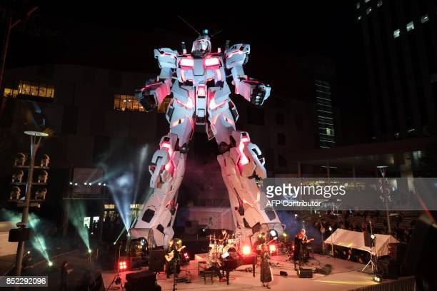 The new fullsize standing statue RX0 Unicorn Gundam from the Mobile Suit Gundam UC anime is unveiled at a press preview in Tokyo on September 23 2017...