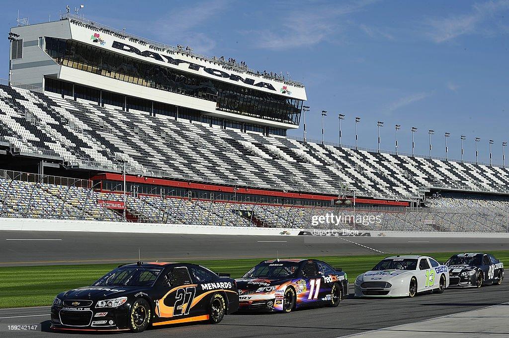 The new Generation 6 NASCAR Sprint Cup cars sit on the grid during NASCAR Sprint Cup Series Preseason Thunder testing at Daytona International Speedway on January 10, 2013 in Daytona Beach, Florida.