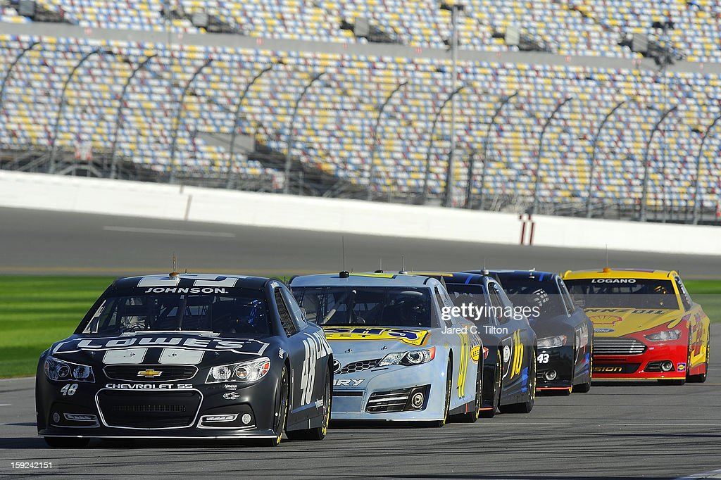 The new Generation 6 NASCAR Sprint Cup cars sit on the grid during NASCAR Sprint Cup Series Preseason Thunder testing at Daytona International Speedway on January 10, 2013 in Daytona Beach, Florida.