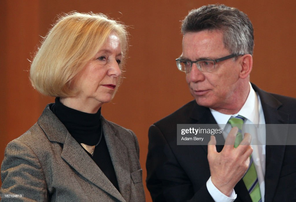The new German Education Minister Johanna Wanka (L) and German Defense Minister <a gi-track='captionPersonalityLinkClicked' href=/galleries/search?phrase=Thomas+de+Maiziere&family=editorial&specificpeople=618845 ng-click='$event.stopPropagation()'>Thomas de Maiziere</a> speak to one another as they arrive for the German federal cabinet meeting on February 19, 2013 in Berlin, Germany. High on the cabinet meeting agenda will be Germany's military role in Mali, for which the country has already promised logistical support based on the situation on the ground to help an initial battle against Islamic insurgents. Germany has also pledged two C-160 transport planes as well as backing an EU plan to send 200 military advisers to the African nation.