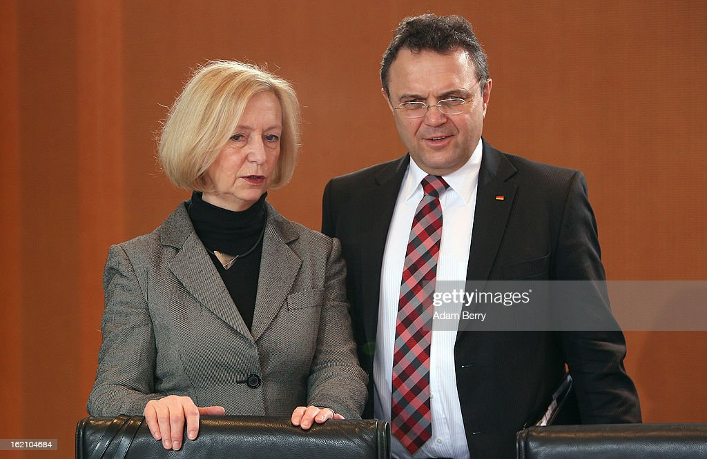 The new German Education Minister Johanna Wanka (L) and German Interior Minister Hans-Peter Friedrich speak to one another as they arrive for the German federal cabinet meeting on February 19, 2013 in Berlin, Germany. High on the cabinet meeting agenda will be Germany's military role in Mali, for which the country has already promised logistical support based on the situation on the ground to help an initial battle against Islamic insurgents. Germany has also pledged two C-160 transport planes as well as backing an EU plan to send 200 military advisers to the African nation.