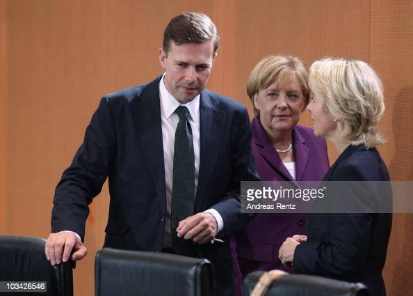 The new German government spokesman Steffen Seibert chats with Ursula von der Leyen Minister of Work and Social Issues as German Chancellor Angela...