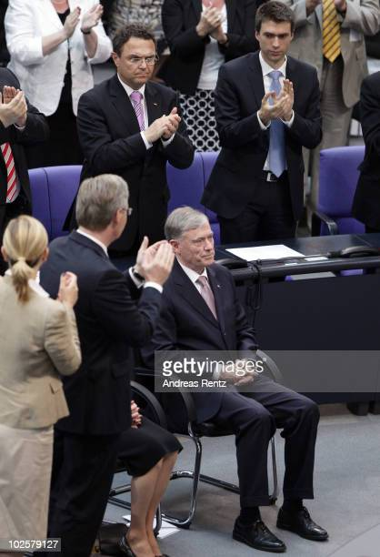 The New German President Christian Wulff and his wife Bettina aplaud former German President Horst Koehler during the official confirmation at the...