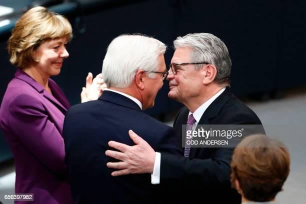 The new German President FrankWalter Steinmeier hugs Germany's outgoing President Joachim Gauck as his partner Daniela Schadt applauses during the...