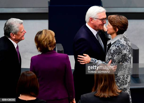 The new German President FrankWalter Steinmeier is congratulated by his wife Elke Buedenbender as Germany's former President Joachim Gauck and as his...