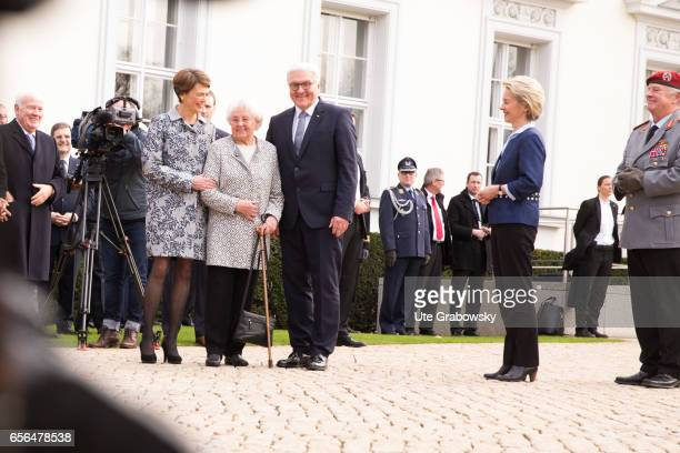 The new German President FrankWalter Steinmeier poses or a photograph with his wife Elke Buedenbender and his mother Ursula Steinmeier during an...