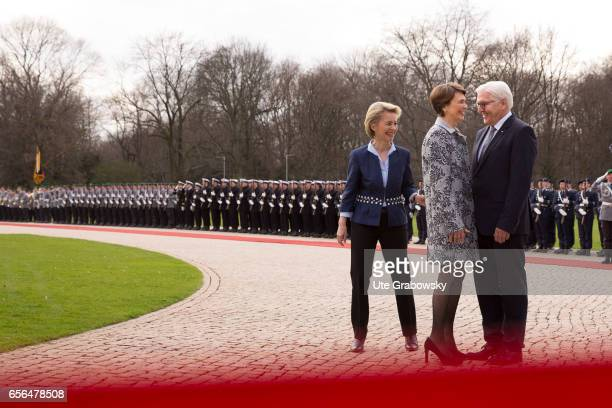 The new German President FrankWalter Steinmeier reviews an honour guard with with German Defence Minister Ursula von der Leyen and Steinmeiers wife...