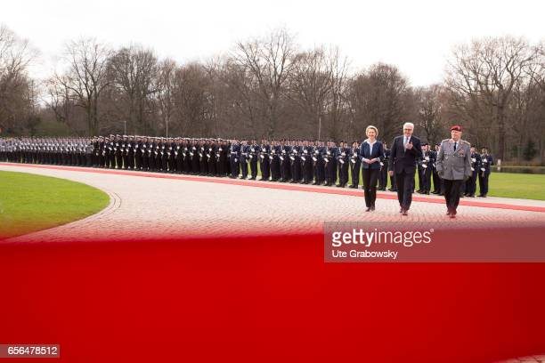 The new German President FrankWalter Steinmeier reviews an honour guard with with German Defence Minister Ursula von der Leyen and the Inspector...