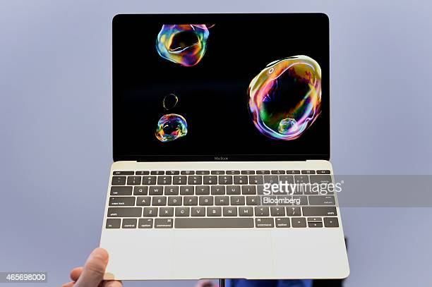 The new gold edition Macbook laptop is displayed during the Apple Inc Spring Forward event in San Francisco California US on Monday March 9 2015...