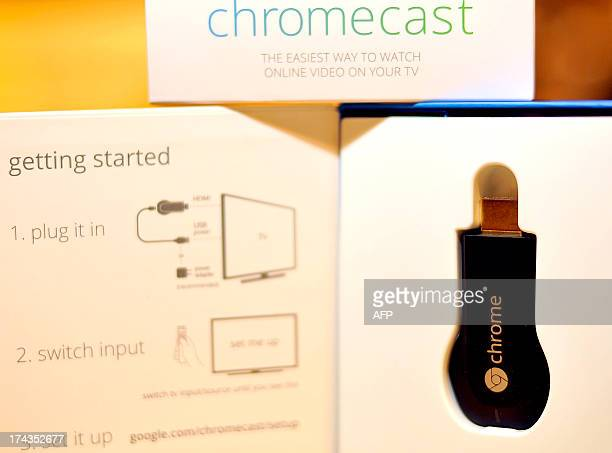The new Google Chromecast is arranged on a table at a media event at Dogpatch Studios on July 24 2013 in San Francisco California Google on Wednesday...