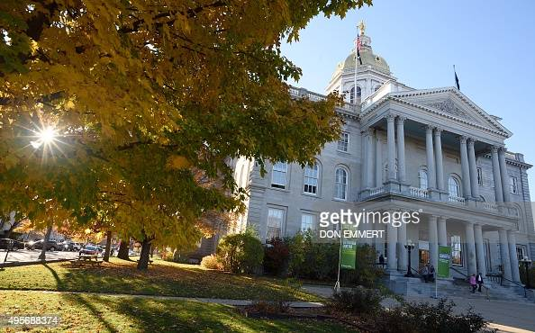 The New Hampshire State House is seen with autumn leaves in Concord New Hampshire on November 4 2015 AFP PHOTO/DON EMMERT