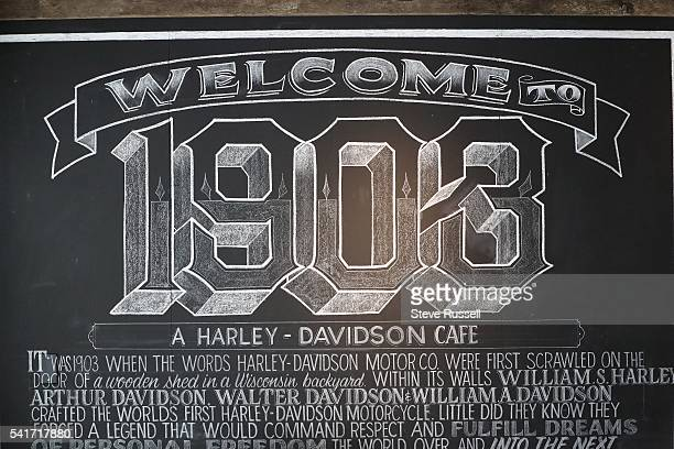 TORONTO ON JUNE 16 The new HarleyDavidson showroom cafe on Ossington Avenue features a coffee bar new and historic motorcycles a garage area a...