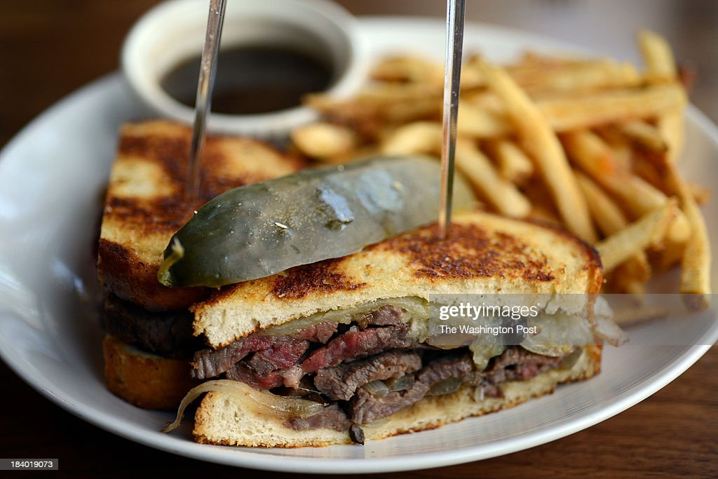 The new Hawk & Dove offers beef sandwich with pickles and fries.