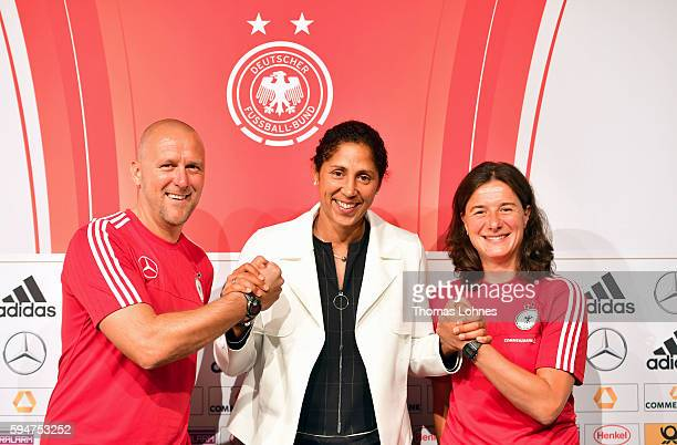 The new head coach of the German women's football team Steffi Jones and her assistent Markus Hoegner and Verena Hagedorn present their strategy at a...