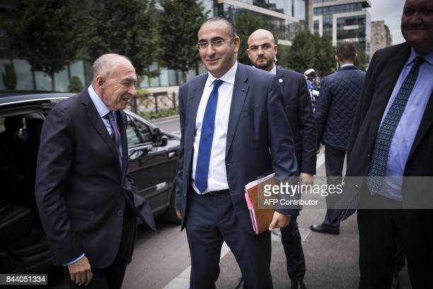 The new head of the DGSI Laurent Nunez arrives next to Interior Minister Gerard Collomb at the DGSI heaquarters in LevalloisPerret on September 8...
