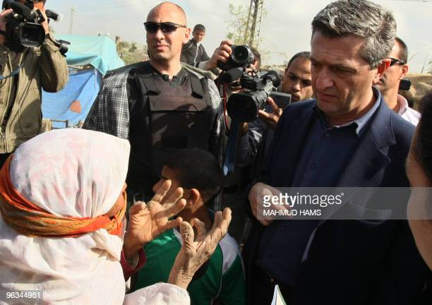 The new head of the UN agency for Palestinian refugees Filippo Grandi of Italy listens to a Palestinian woman during a visit to an area in the...