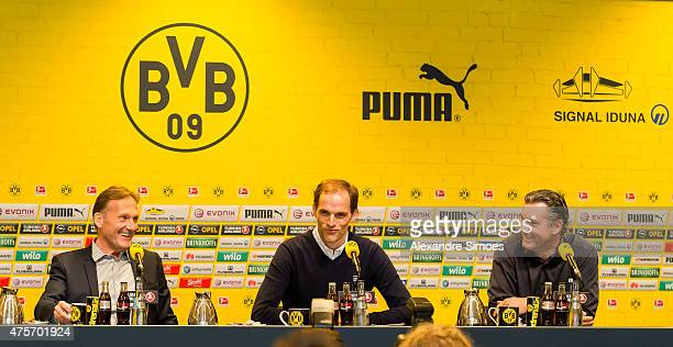 The new headcoach of Borussia Dortmund Thomas Tuchel CEO HansJoachim Watzke and Sportmanager Michael Zorc attend a news conference at Signal Iduna...