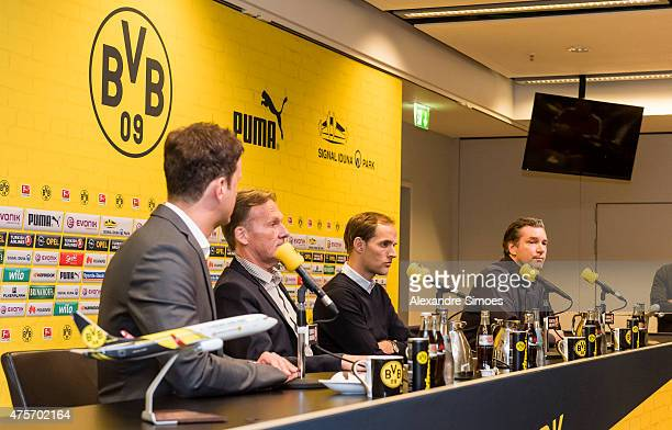 The new headcoach of Borussia Dortmund Thomas Tuchel m CEO HansJoachim Watzke l and Sportmanager Michael Zorc attends a news conference at Signal...
