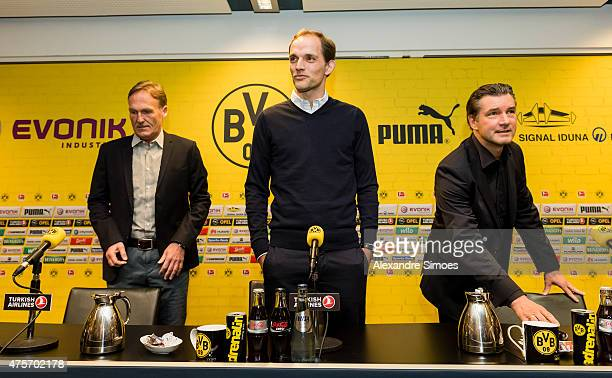 The new headcoach of Borussia Dortmund Thomas Tuchel m CEO HansJoachim Watzke l and Sportmanager Michael Zorc r attends a news conference at Signal...