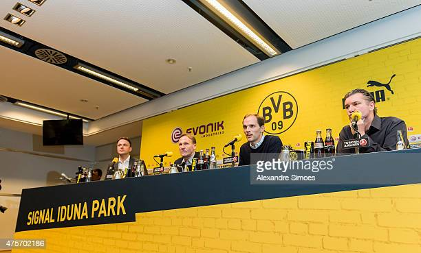 The new headcoach of Borussia Dortmund Thomas Tuchel m CEO HansJoachim Watzke l and Sportmanager Michael Zorc r with attends a news conference at...