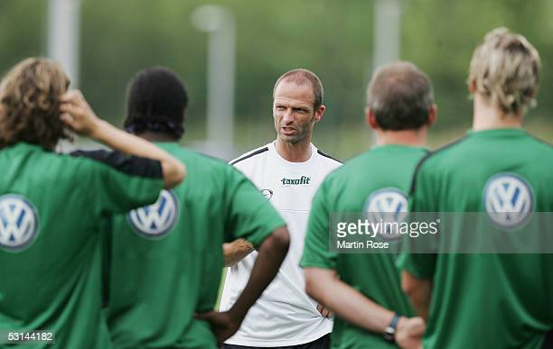The new headcoach of Wolfsburg Holger Fach talks to the team during the training session of VFL Wolfsburg for the Bundesliga Season 2005 2006 on June...