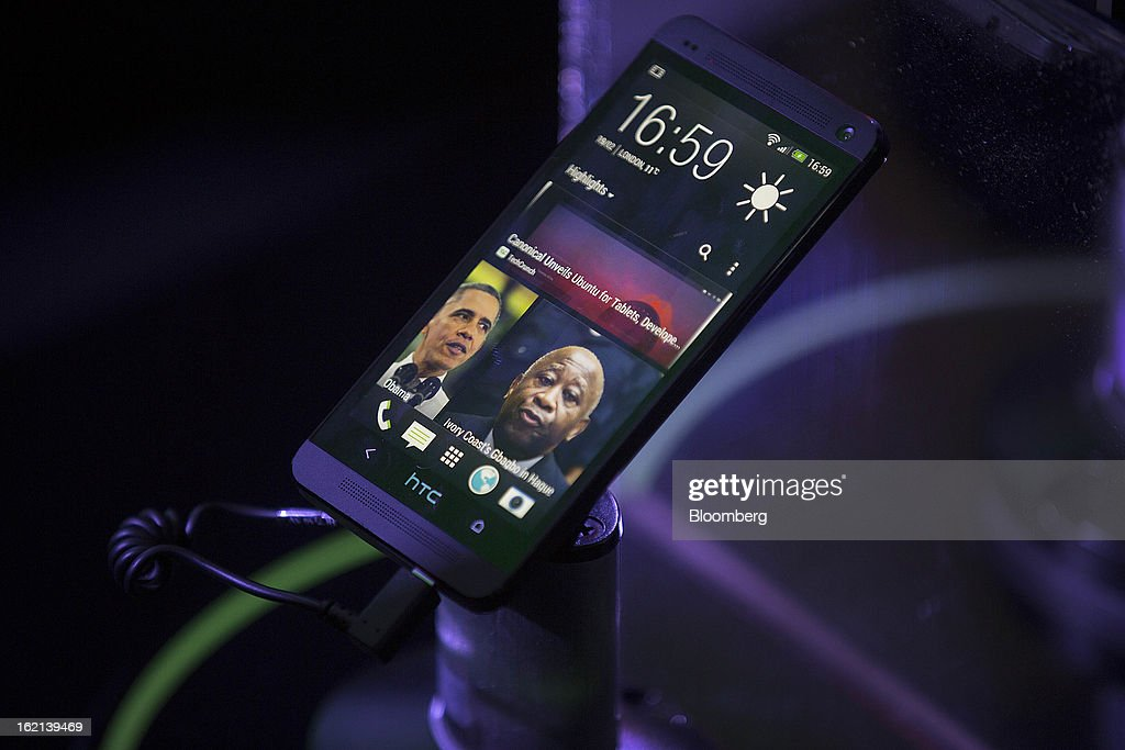 The new HTC One smartphone sits on display during a launch event in London, U.K., on Tuesday, Feb. 19, 2013. HTC Corp. introduced its new flagship HTC One smartphone at a launch event in London today. Photographer: Simon Dawson/Bloomberg via Getty Images