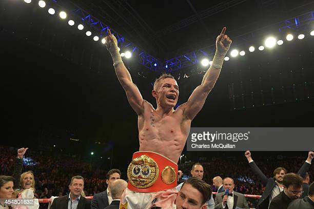 The new IBF superbantamweight world champion Carl Frampton of Northern Ireland celebrates after his victory over Kiko Martinez of Spain at the...