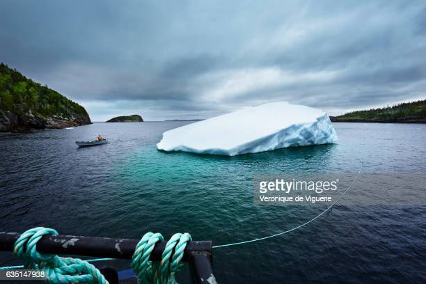 The new iceberg found by Ed Kean is attached to the barge As more icebergs drift south due to climate change a few enterprising seafarers have begun...