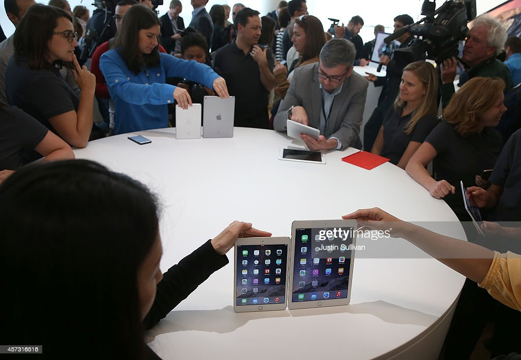 The new iPad Air 2 and iPad Mini 3 are displayed during an Apple special event on October 16 2014 in Cupertino California Apple unveiled the new iPad...