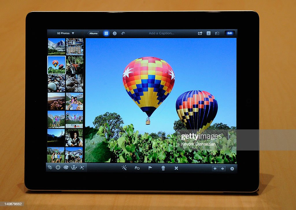 The new iPad is displayed with the iPhoto app during an Apple product launch event at Yerba Buena Center for the Arts on March 7, 2012 in San Francisco, California. In the first product release following the death of Steve Jobs, Apple Inc. introduced the third version of the iPad and an updated Apple TV.