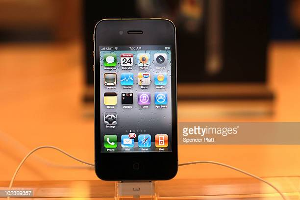 The new iPhone 4 which went on sale this morning is displayed at the flagship Apple Store on Fifth Avenue on June 24 2010 in New York City People...