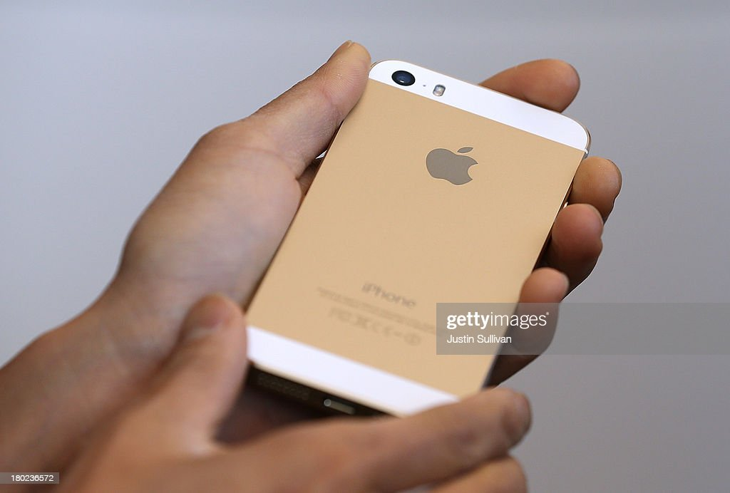 The new iPhone 5S is displayed during an Apple product announcement at the Apple campus on September 10, 2013 in Cupertino, California. The company launched the new iPhone 5C model that will run iOS 7 is made from hard-coated polycarbonate and comes in various colors and the iPhone 5S that features fingerprint recognition security.