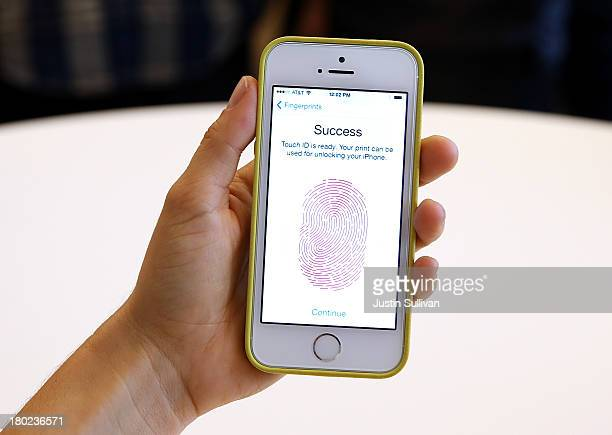 The new iPhone 5S with fingerprint technology is displayed during an Apple product announcement at the Apple campus on September 10 2013 in Cupertino...