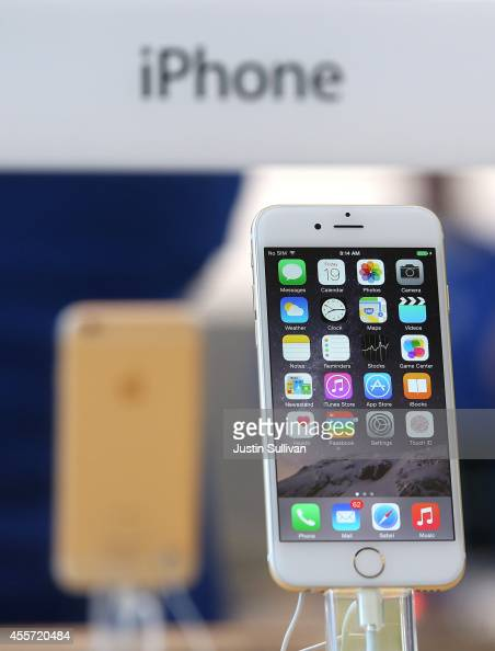 The new iPhone 6 is displayed at an Apple Store on September 19 2014 in Palo Alto California Hundreds of people lined up to purchase the new iPhone 6...