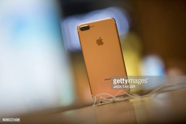 The new iPhone 7 smartphone is on display on the day of its release at Covent Garden in London on September 16 2016 Apple's iPhone 7 launch generated...