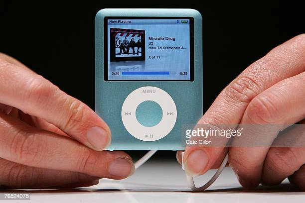 The new Ipod Nano is held at the UK launch of the product at the BBC on September 5 2007 in London England Steve Jobs spoke to the press at the...