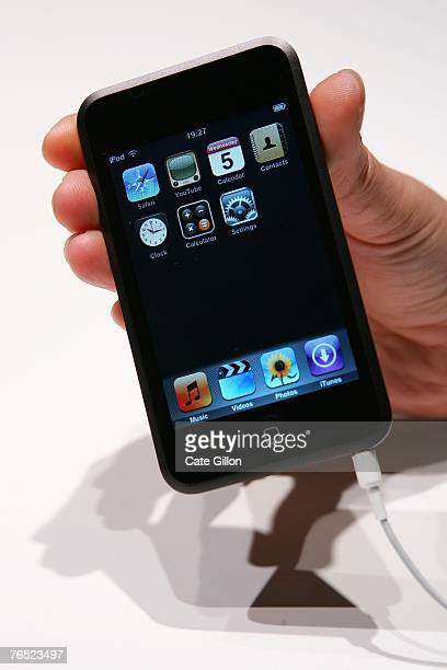 The new Ipod Touch is held at the UK launch of the product at the BBC on September 5 2007 in London England Steve Jobs spoke to the press at the...